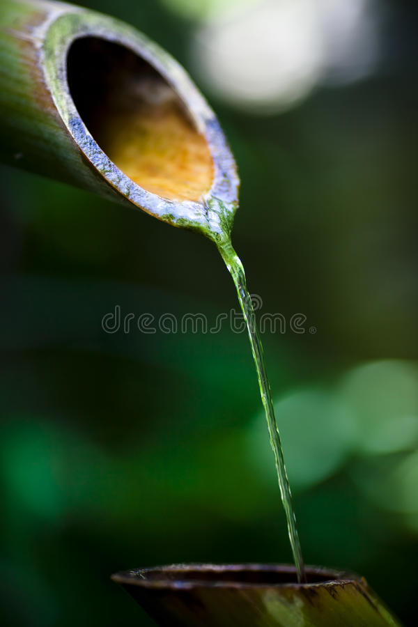 Water pouring from spout stock images