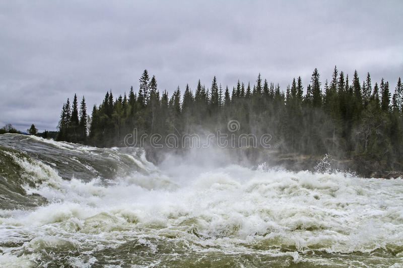 Water power. Besides the E 6 the wild river thunders with a roar into the valley royalty free stock image