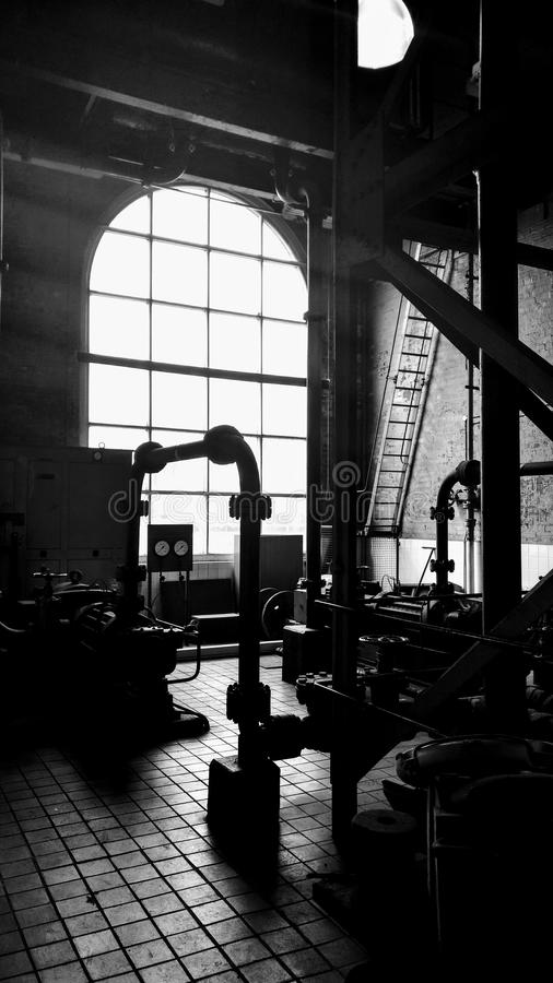 Water pump house. Pipes, old water pump house shipyard royalty free stock images