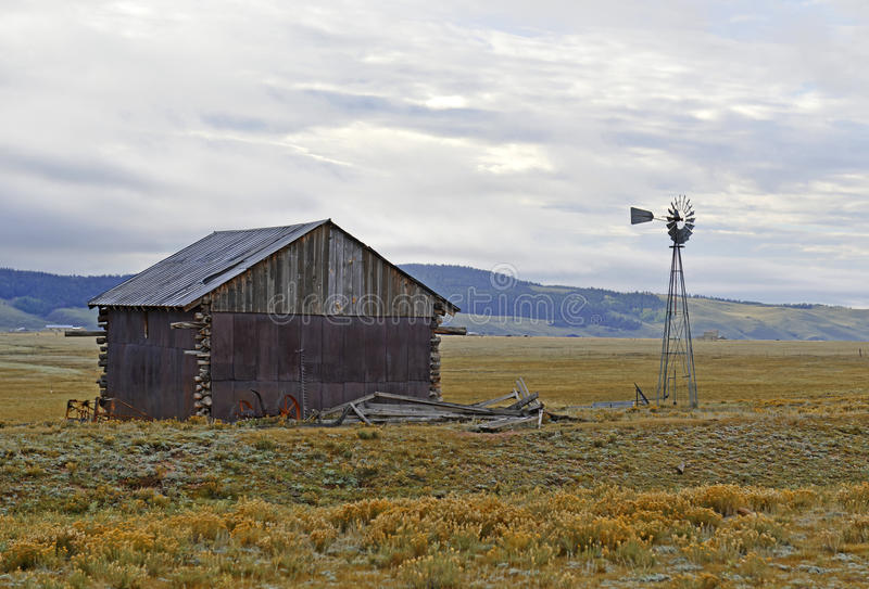 Water pump / windmill in a rural landscape. American West royalty free stock images