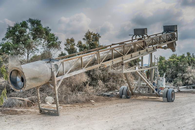 Water pumping machine with wheels. Water pumping machine in Kibbutz `Maagan Michael` Center of the Land of Israel stock photos