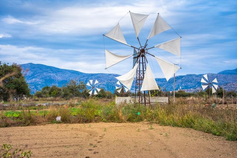 Water pumps driven by wind on the mountain plateau Lasithi in the inland of the island of Crete. royalty free stock photos