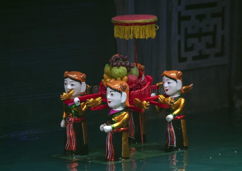 Water puppets women carrying fruit in the Thang Long Water Puppet Theatre, Hanoi, Vietnam stock images