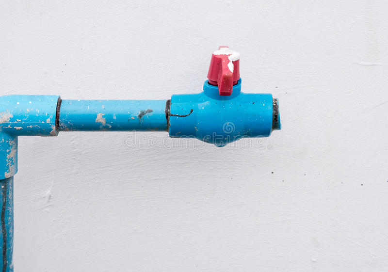 Water PVC pipe with the red plastic valve. stock image