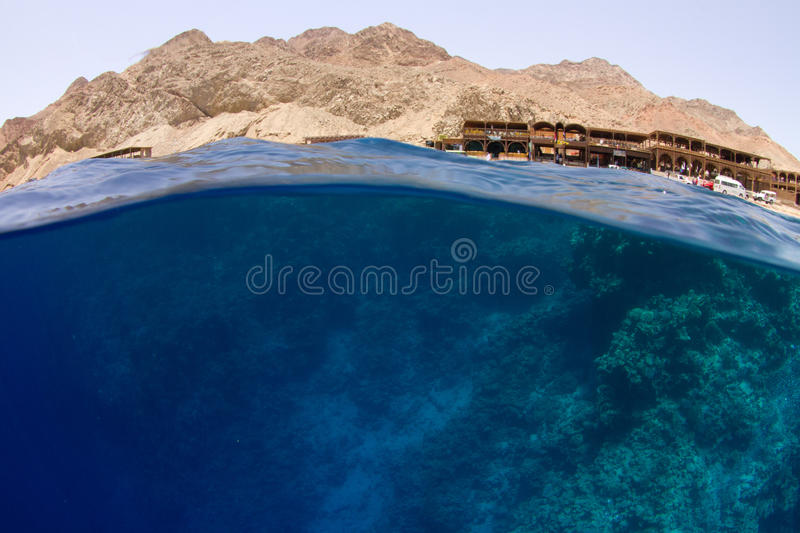 Download Water With Reef And Desert Mountains Stock Image - Image: 20243507