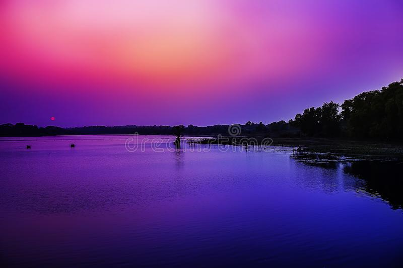 Water Reflecting the Dreamy Sunset sky in the Bank of River. royalty free stock photography