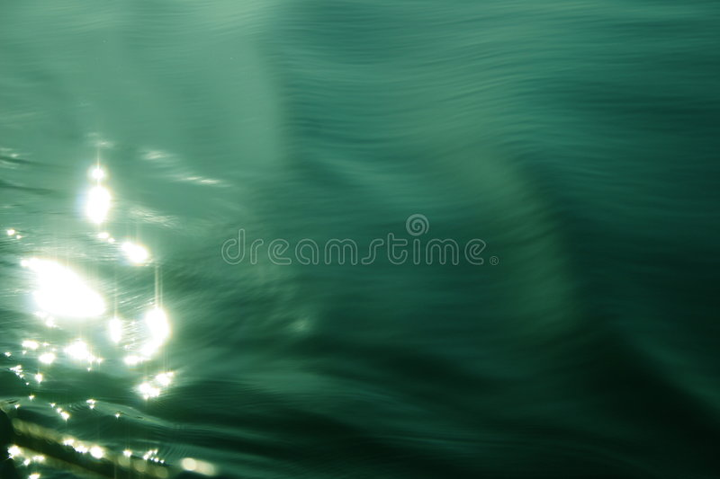 Water reflection. The sun reflects over the water. Taken from a moving boat stock photos