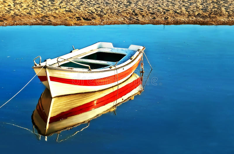 Water reflection of a fishing boat royalty free stock photo