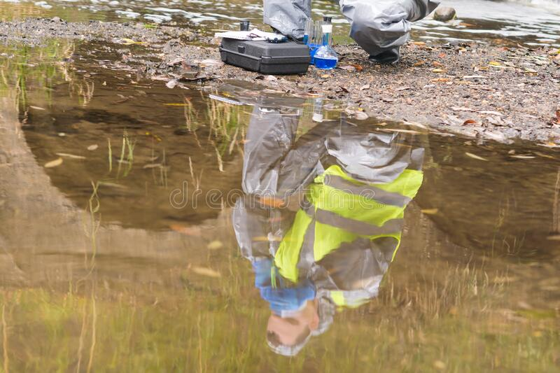 In water reflection of a man in a protective suit and mask royalty free stock images
