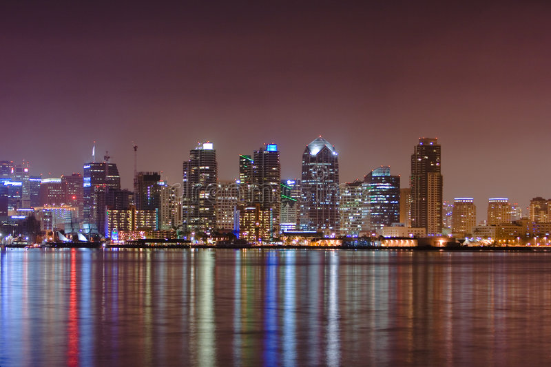 Water reflection of San Diego skyline. San Diego's skyline is reflected along its coastal waters royalty free stock image