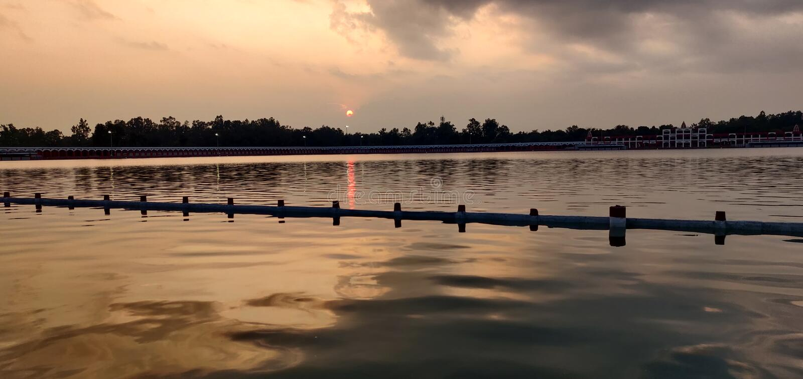 Water reflection view with sun royalty free stock photography
