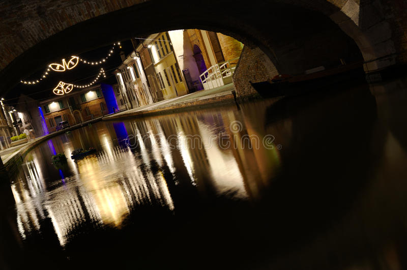 Water reflections by night. In Comacchio, Italy stock photography