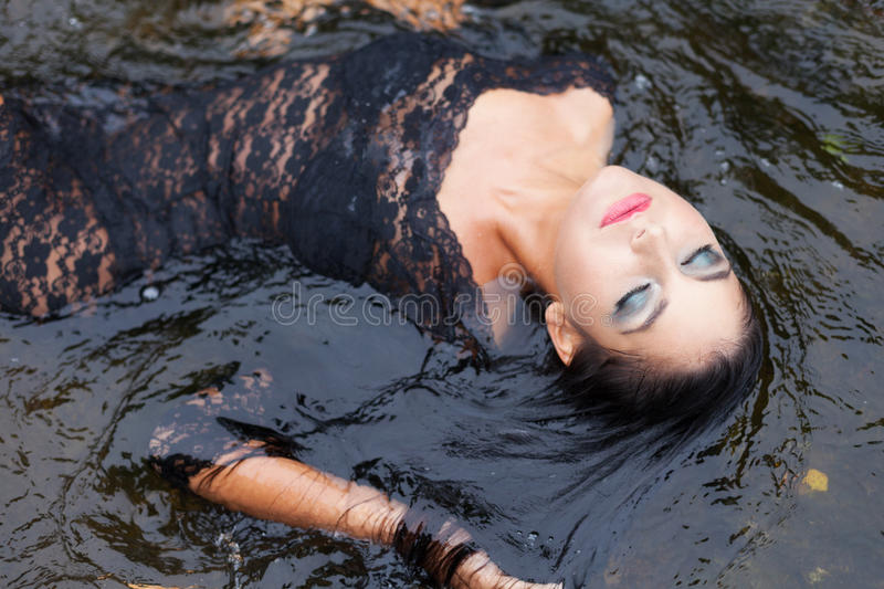 Water relax. Luxury girl relaxing in floating water royalty free stock photos