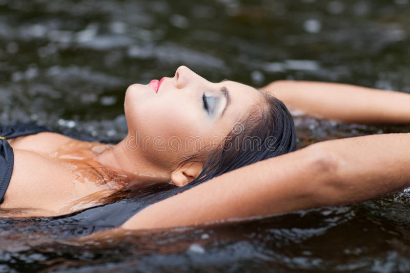Water relax. Sensual woman relaxing in the water royalty free stock photography