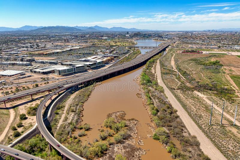 Water release into the Salt River flowing towards the Tempe Town Lake. Water released into the Salt River leading to the Tempe Town Lake due to recent rains royalty free stock photo
