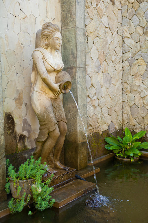 Bali spa statue. Water is released from the statues in Bali, Indonesia stock photography