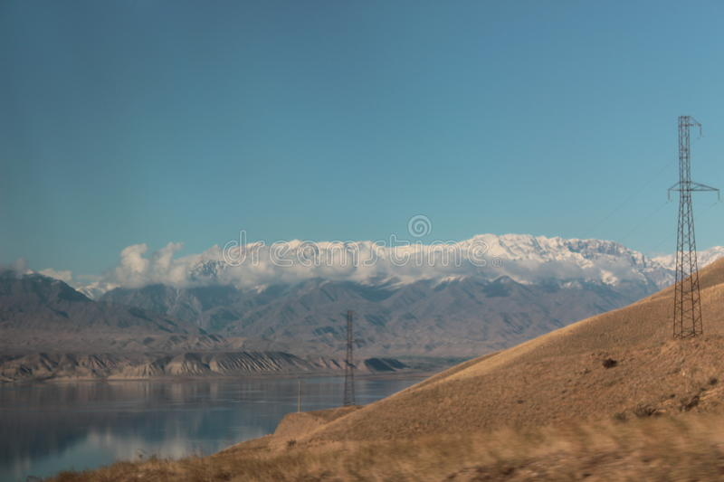 Water reservoir in Kyrgyzstan royalty free stock photography