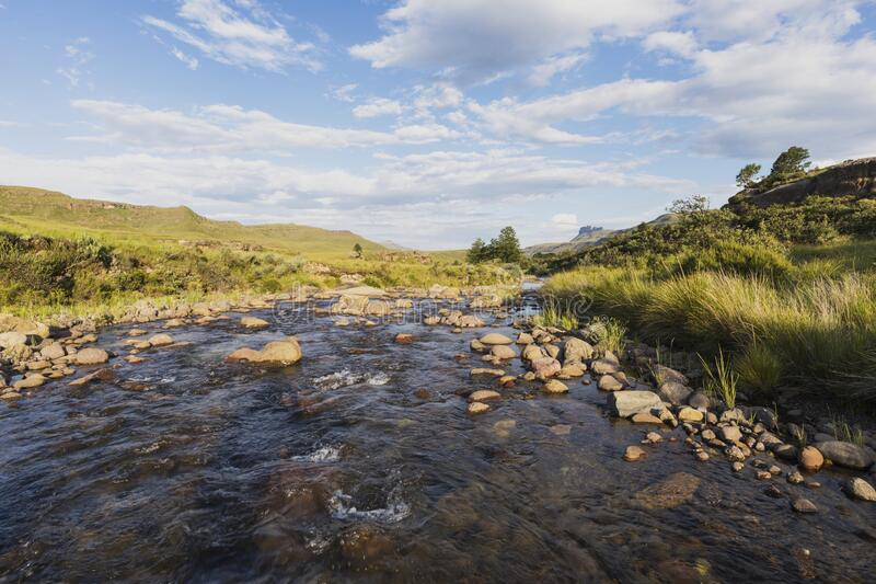 Water in the river run over rocks. Drakensberg South Africa stock photos