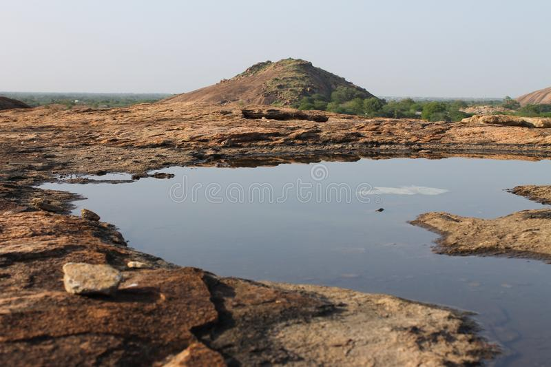 Download Water on rock stock photo. Image of stagnated, rocky - 26216894