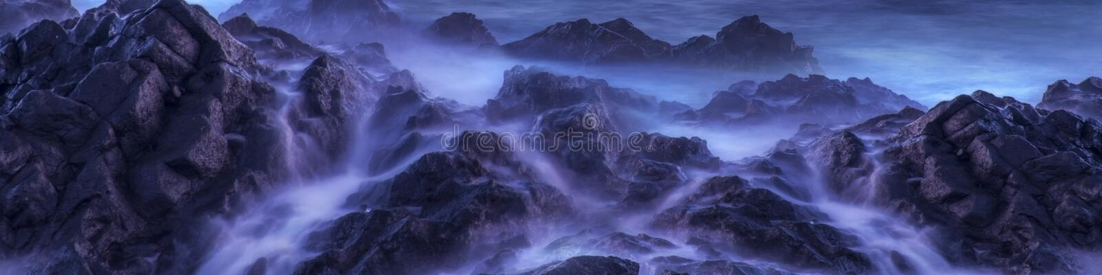 Water with rock nature photo with long exposure fog effect.Panorama or banner abstract color ocean background royalty free stock images
