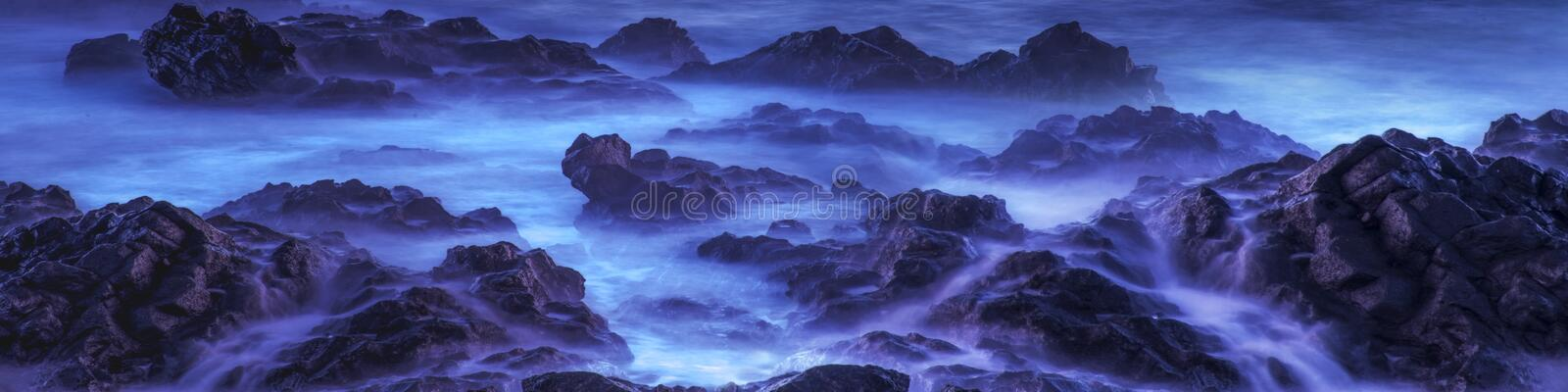 Water with rock nature photo with long exposure fog effect.Panorama or banner abstract color ocean background royalty free stock photo