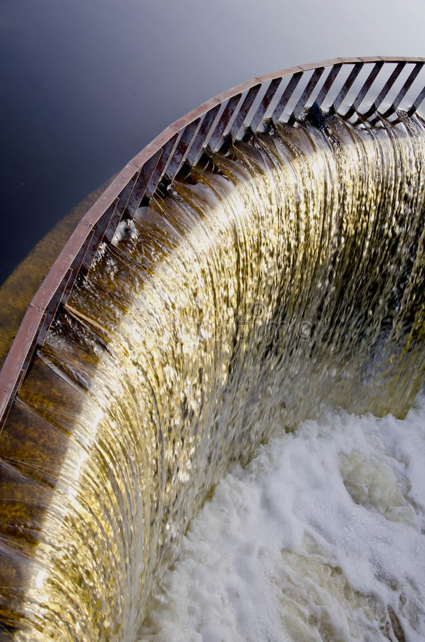 Water runs through dam. stock photography