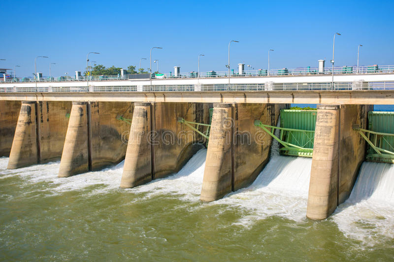 Water rushing through gates at a dam stock photography