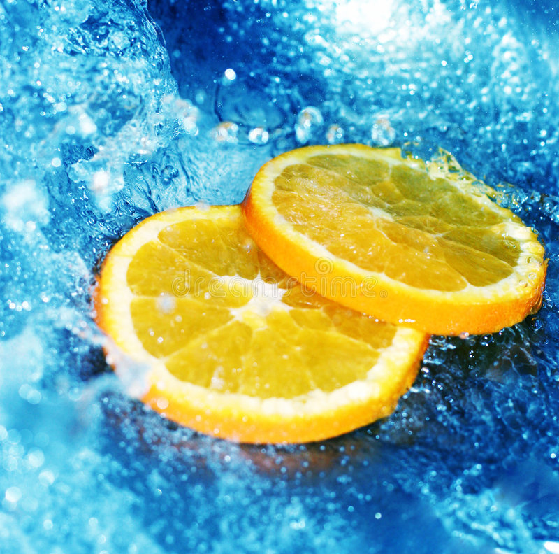 Water rushing with orange slices royalty free stock image
