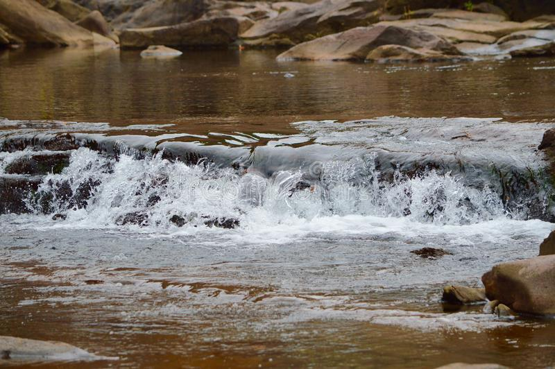 The Water rushing over Rocks stock image