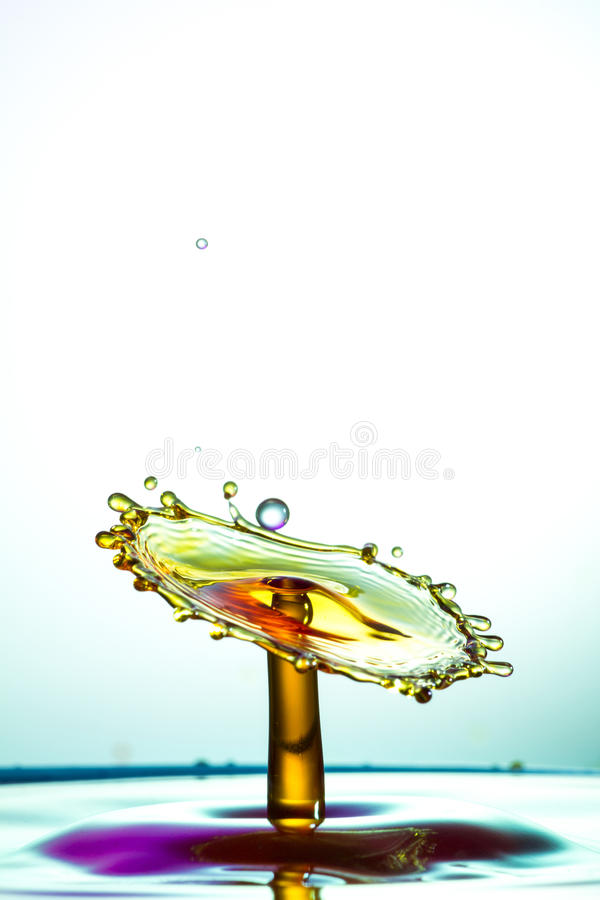 Water sculpture. Water drops falling into each other and breaking. royalty free stock photography