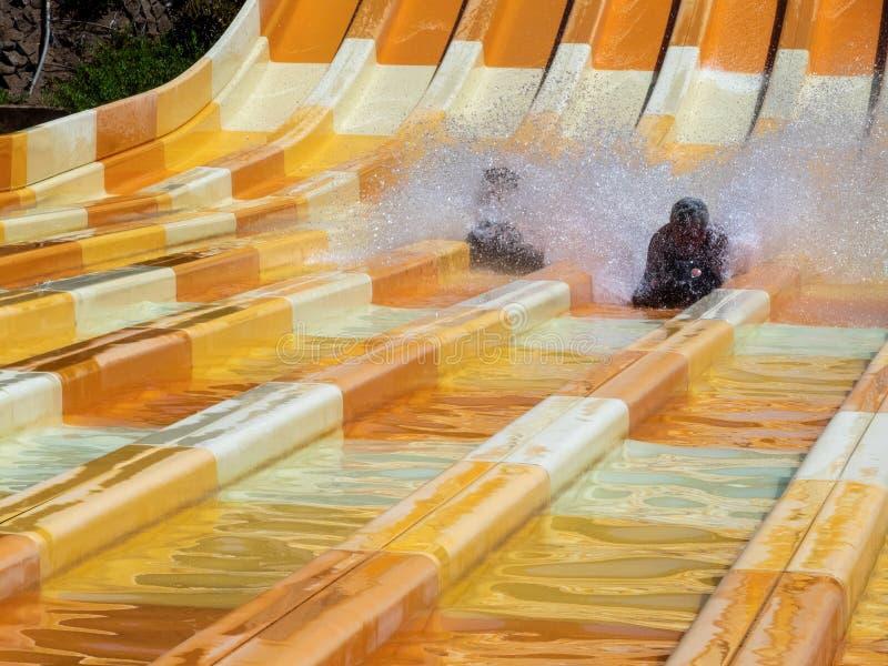 Water slide at Aqualand park in Maspalomas, Gran Canaria. Gran Canaria/Spain - August 20 2019: Aqualand is a chain of Spanish water-amusement parks. Maspalomas royalty free stock images