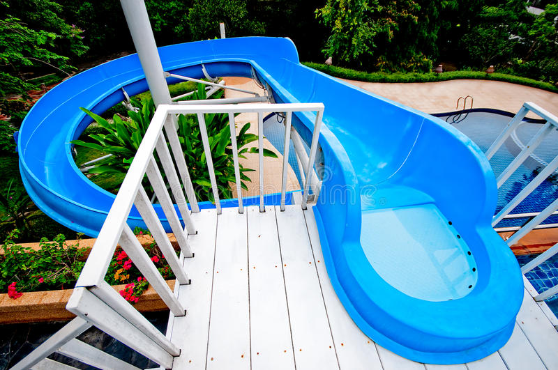 The Water slide of pool. In the forest royalty free stock image