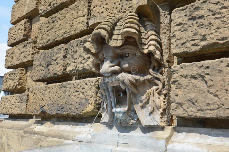 Water spitting gargoyle head at Water Tour called `Wasserturm` in Mannheim royalty free stock photo