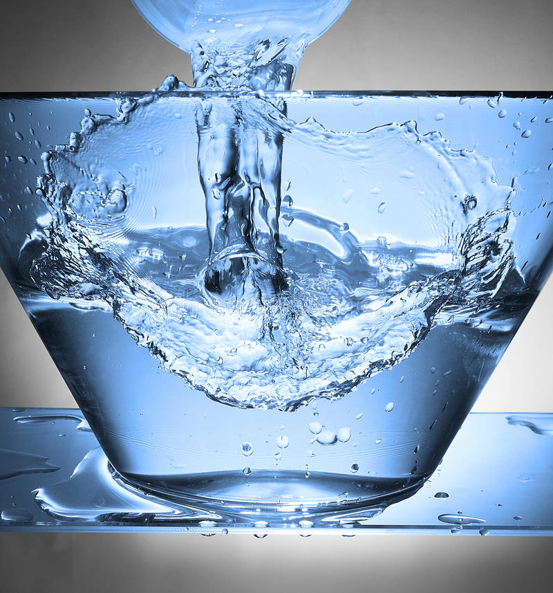 Water splash in a bowl royalty free stock photography