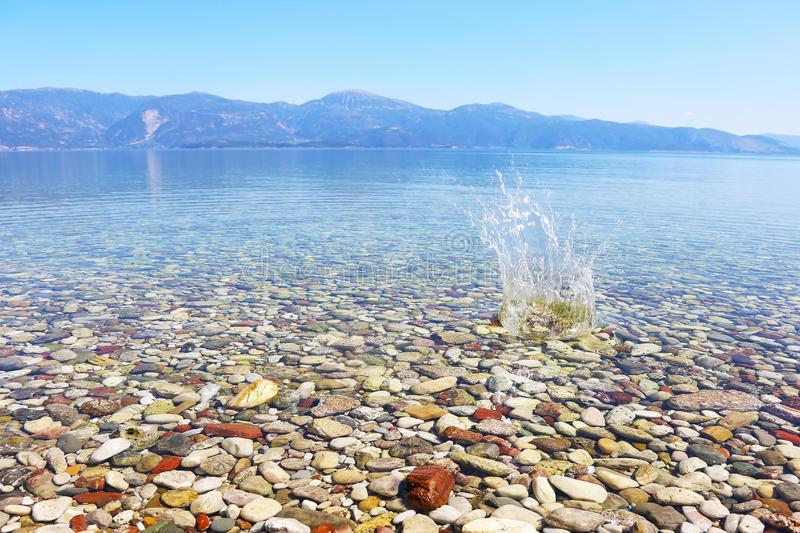 Water splash on crystal clear water of Peloponnese Greece royalty free stock images