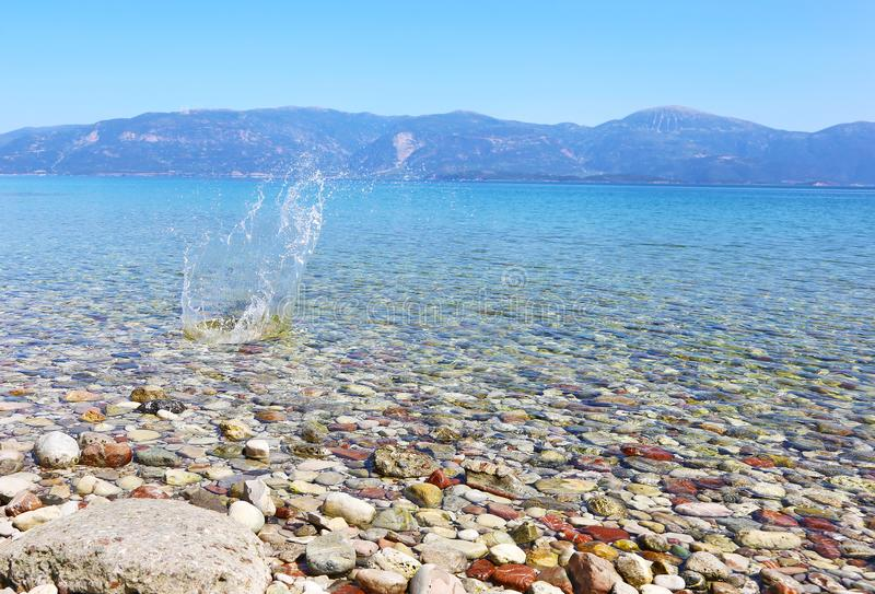 Water splash on crystal clear water of Peloponnese Greece royalty free stock image