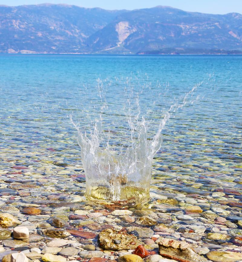 Water splash on crystal clear water of Peloponnese Greece royalty free stock photo