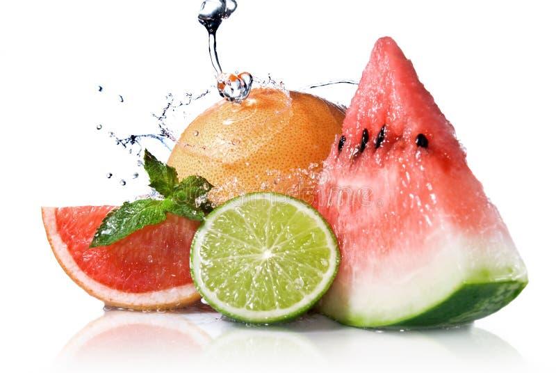 Water splash on fresh fruits royalty free stock photography