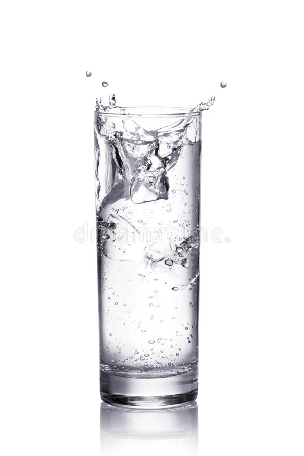 Water splash in a glass stock images