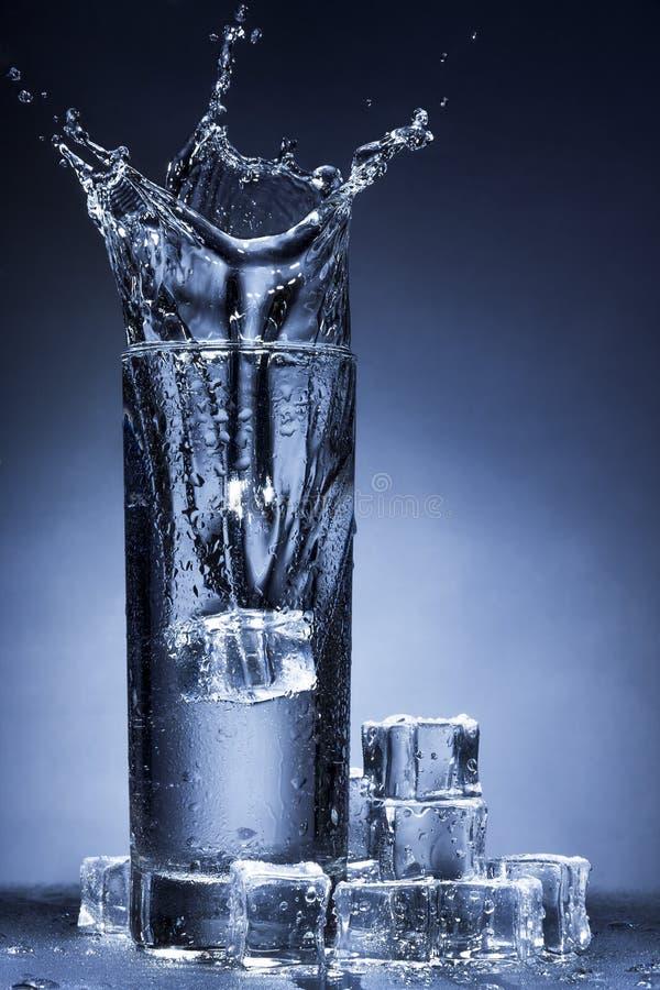 Water splash in a glass. stock photo