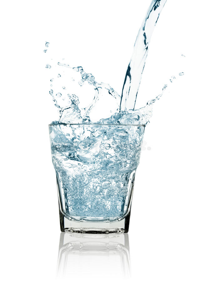 Water splash in a glass stock image