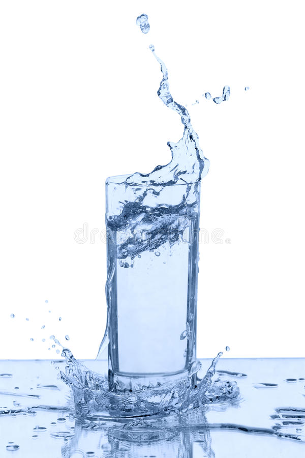 Water splash in glass royalty free stock photography