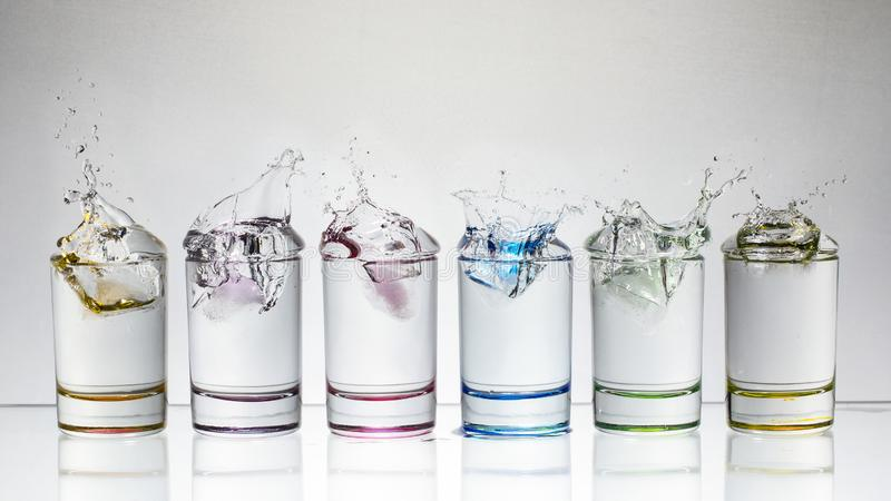 Water splash in glasses isolated on white. Background stock photos