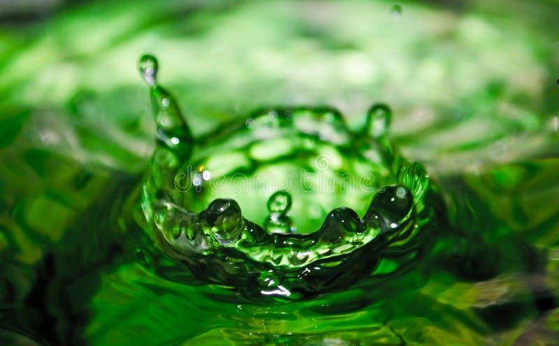 Water splash on green. Background royalty free stock photos