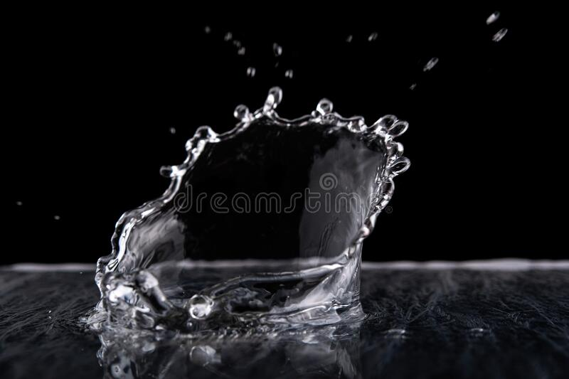 Water splash isolated on black background.  Water texture stock image