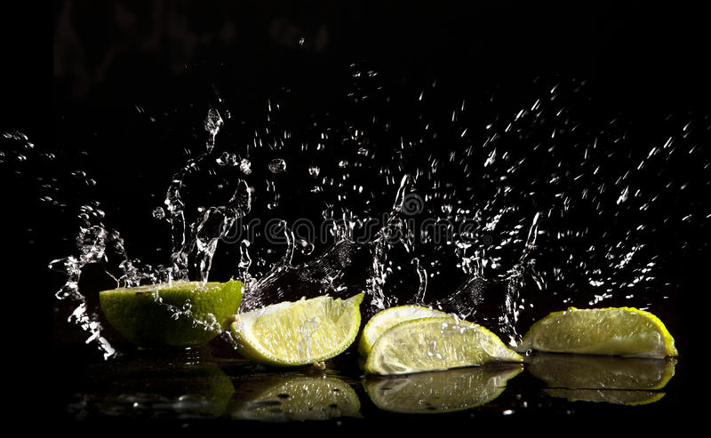 Download Water splash and limes stock image. Image of falling - 23194033