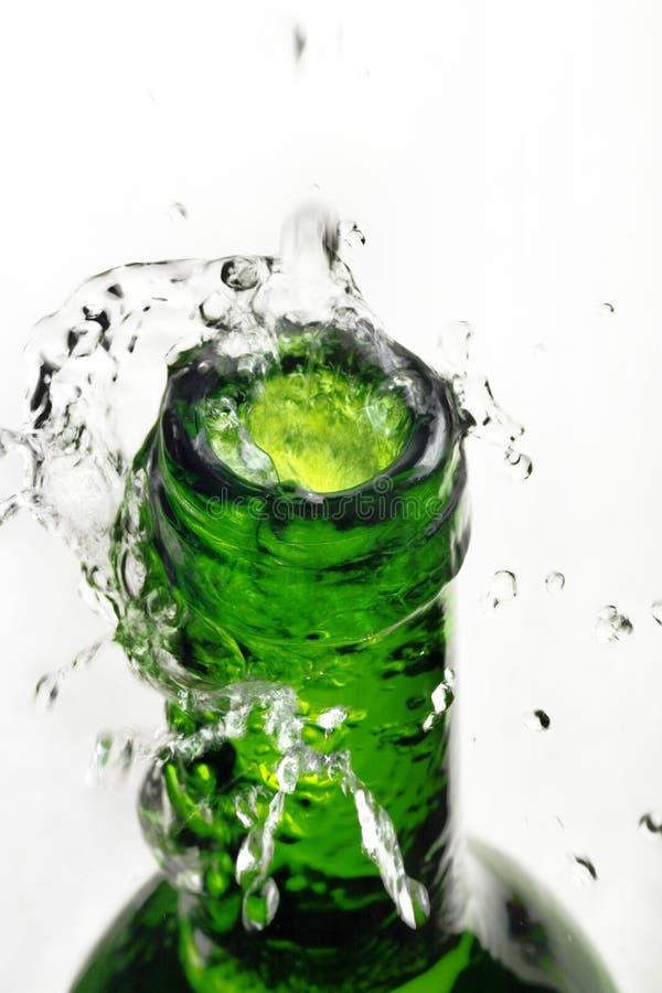 Water splash over bottle royalty free stock images