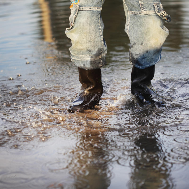Download Water splash in puddle stock image. Image of concentric - 20609705