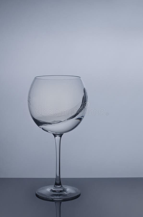 Water splash in round glass.  royalty free stock photo