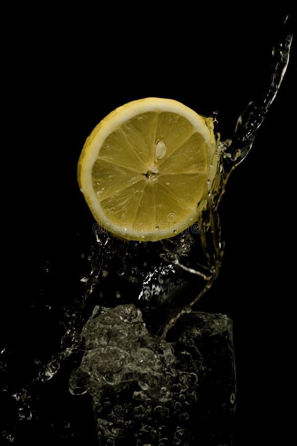 Water splashing with lemon.